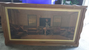 Photo of an old framed painting