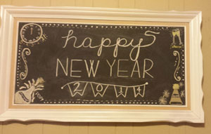 Framed chalkboard with writing on it