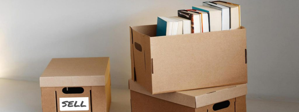 Books in boxes labeled sell