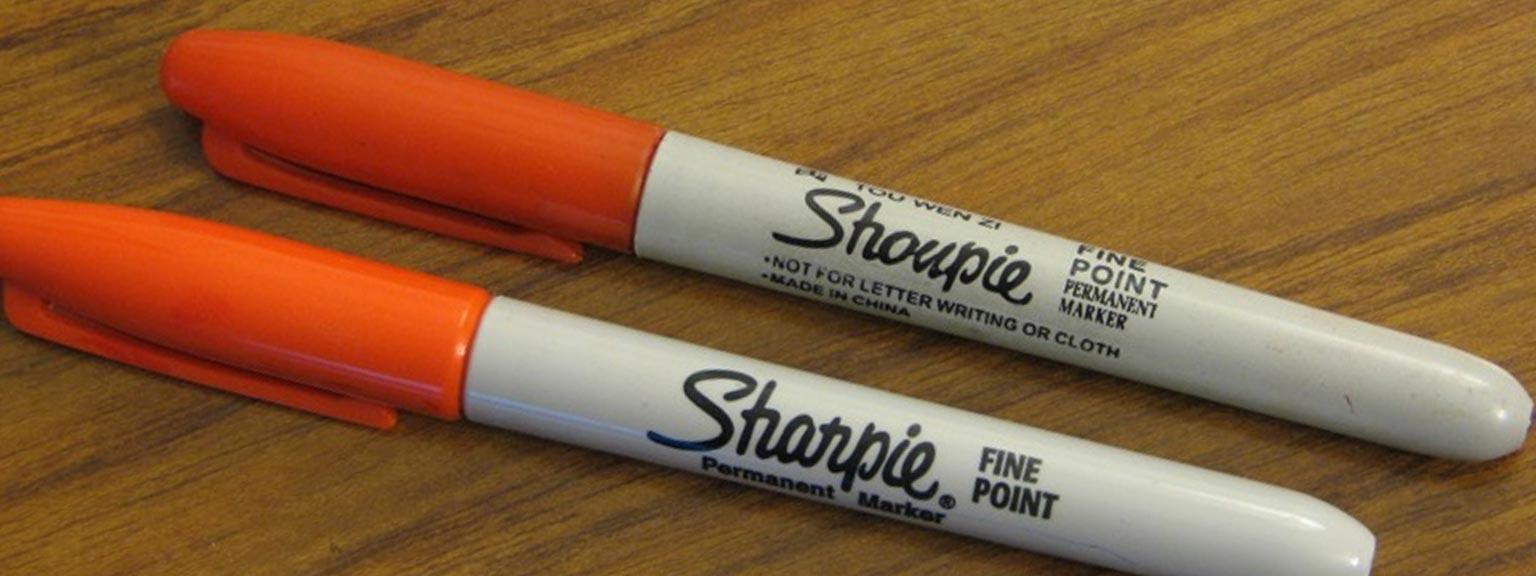 "Real Sharpie marker next to a counterfeit ""Shoupie"" marker"